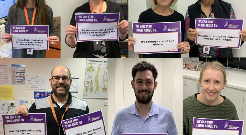 """A group of people holding up pieces of paper on which they have each written """"We can stop elder abuse by..."""" with their various answers."""