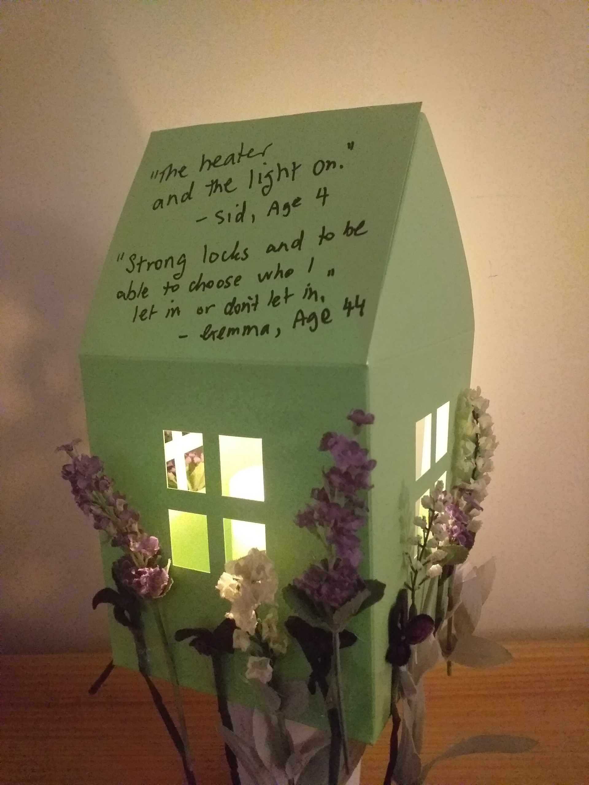A green Warm Safe Home with flowers